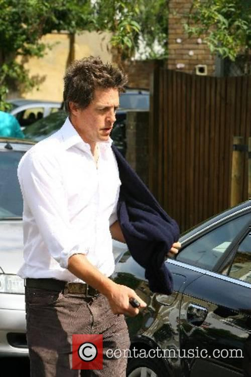 Hugh Grant leaving Jemima Khan's house shortly after...