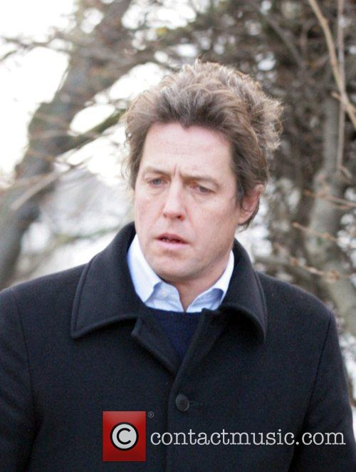 Hugh Grant returns home after visiting the local...