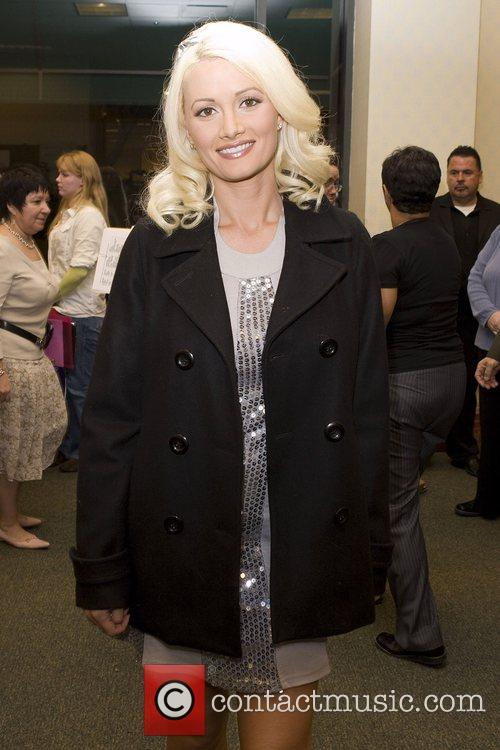 Holly Madison signs copies of 'Playboy Cover To...