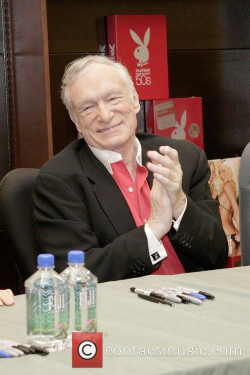 Hugh Hefner signs copies of 'Playboy Cover To...
