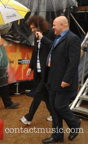 Brian May leaving the Chris Cornell Concert performing...
