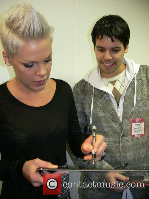Pink (Alecia Moore) signing autographs during a