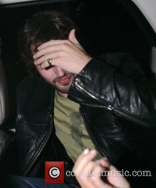 James Blunt trying to hide his face from...