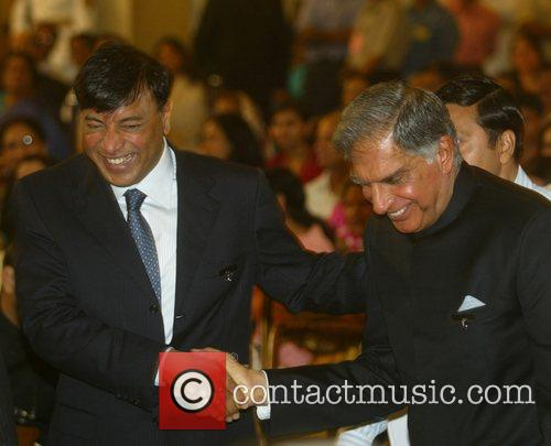 Lakshmi Niwas Mittal and Ratan Tata receive the...