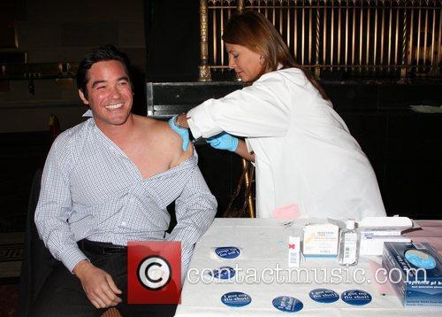 Dean Cain receives a flu shot Jennifer Garner...