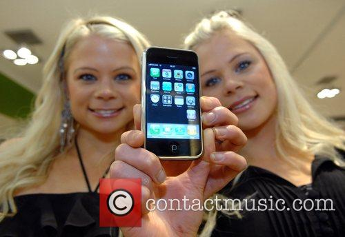 Models pose with the new Apple iPhone at...