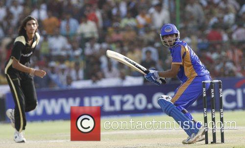 Rajasthan Royals' Ravindra Jadeja, right, plays a shot,...