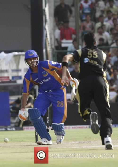 Rajasthan Royals' Yusuf Pathan, left, plays a shot...