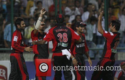 Pradeep Sangwan (2nd left) of Delhi Daredevils celebrates...