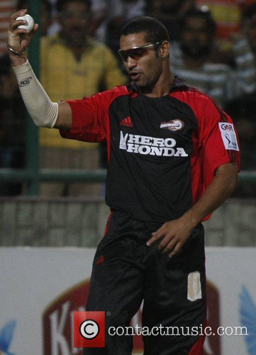 Pradeep Sangwan player of Delhi Daredevils celebrates during...