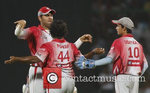 Ramesh Powar (without cap) and Yuvraj Singh, left,...