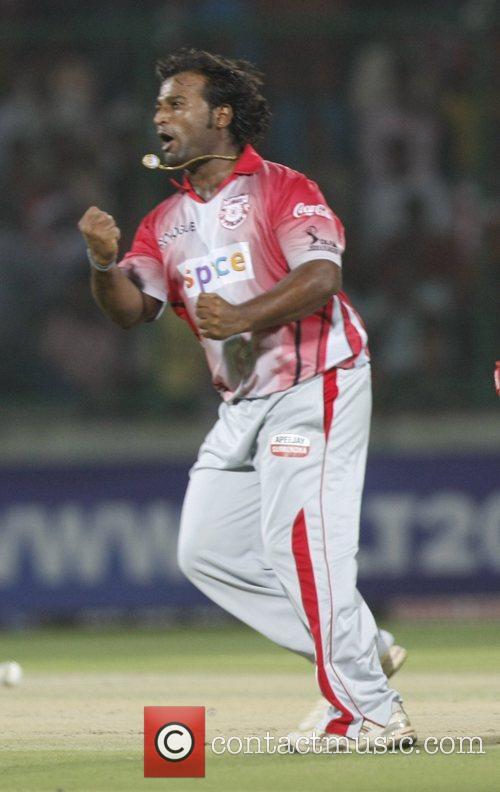 Ramesh Powar of Kings XI Punjab celebrates the...