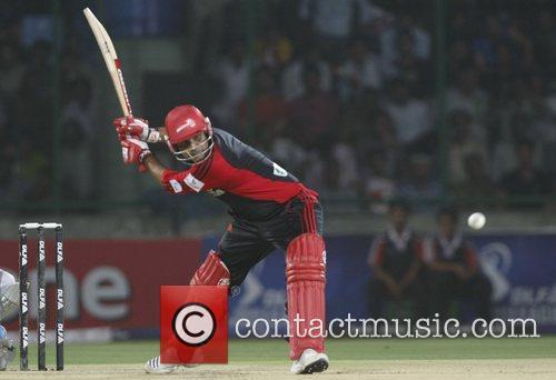 Virender Sehwag captian of Delhi Daredevils plays a...
