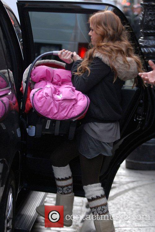 Leaving her Soho hotel carrying a baby car...