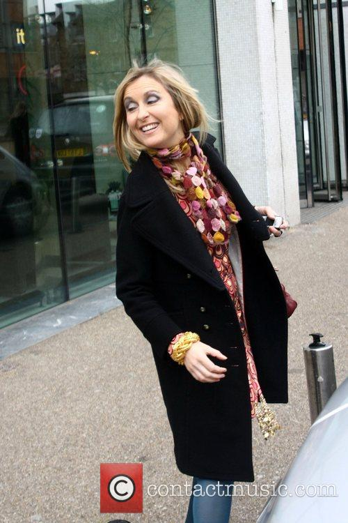 Fiona Phillips smiles as she get into a...