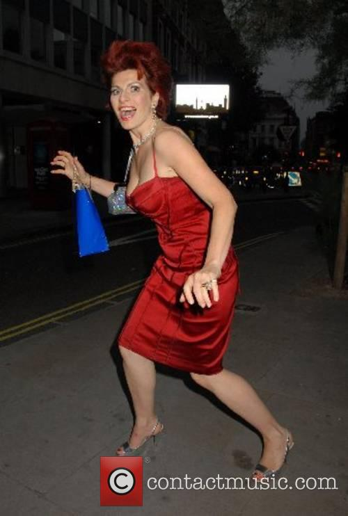 Cleo Rocos leaving the Ivy with a doggie...