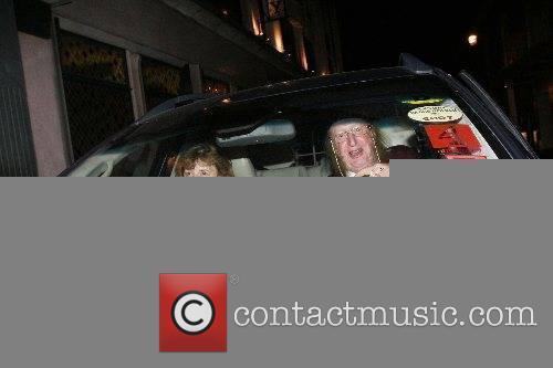 John McCririck and wife Jenny aka Booby leaving...