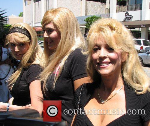Judy Landers with her daughters Lindsay Landers and...