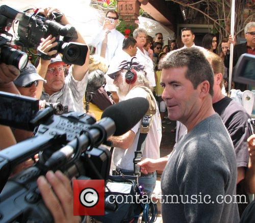 Simon Cowell getting mobbed by fans outside the...