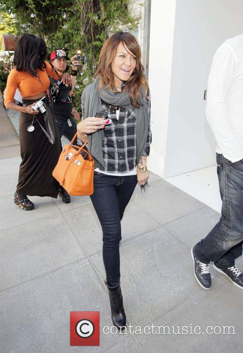 Robin Antin leaving the Ivy restaurant with a...