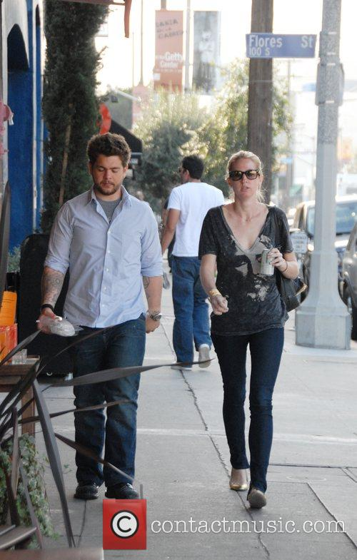 Jack Osbourne walks to his car with a...