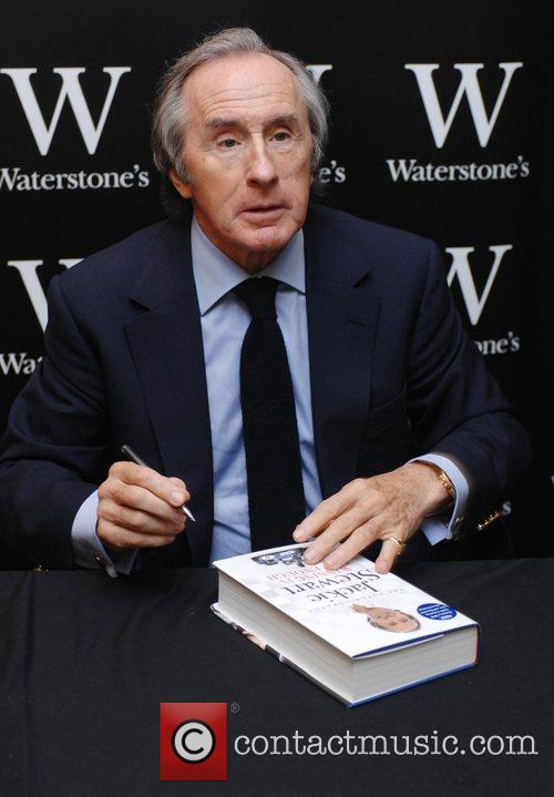 Jackie Stewart signing copies of his autobiography 'Winning...