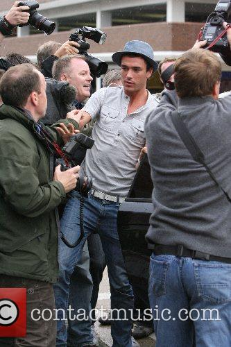 Jack Tweed gets into a scuffle with photographers...
