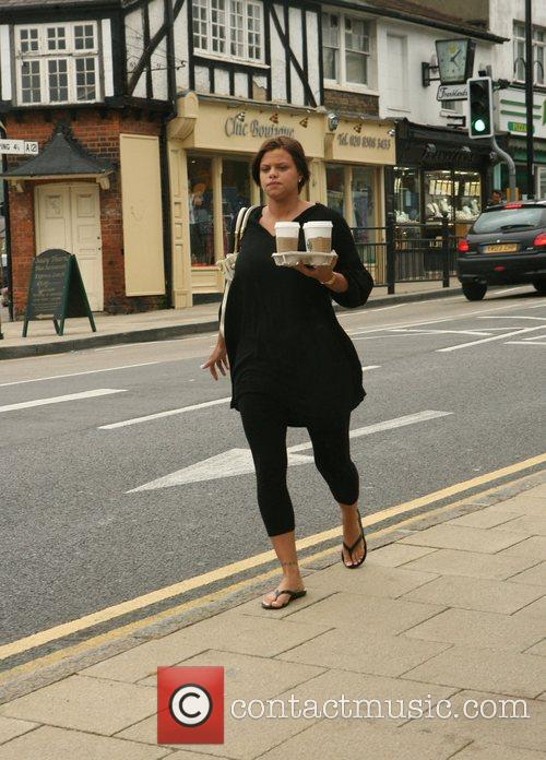 Jade Goody carrying a tray of drink which...