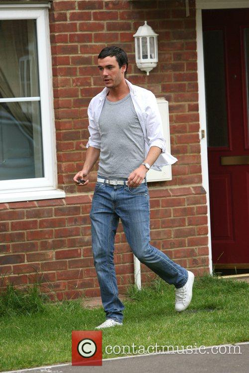 Jack Tweedy leaving his house to view a...