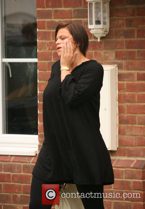 Jade Goody leaving her house to view a...