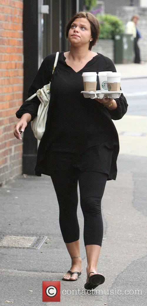Jade Goody walks with a tray of coffee's...