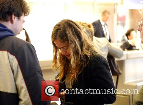 Jade Jagger in Tegel Airport signing autographs before...
