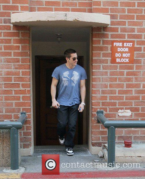Jake Gyllenhaal leaving a medical building thru the...