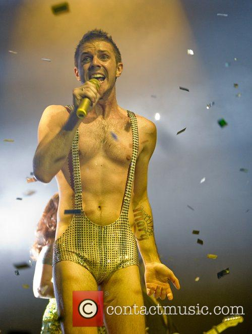 Wearing a gold sequined leotard when performing the...