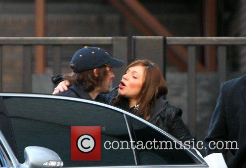 Kisses a mystery girl outside ITV studios