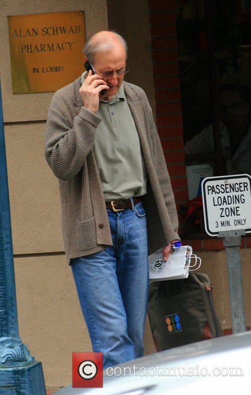 James Cromwell talks on his mobile phone...
