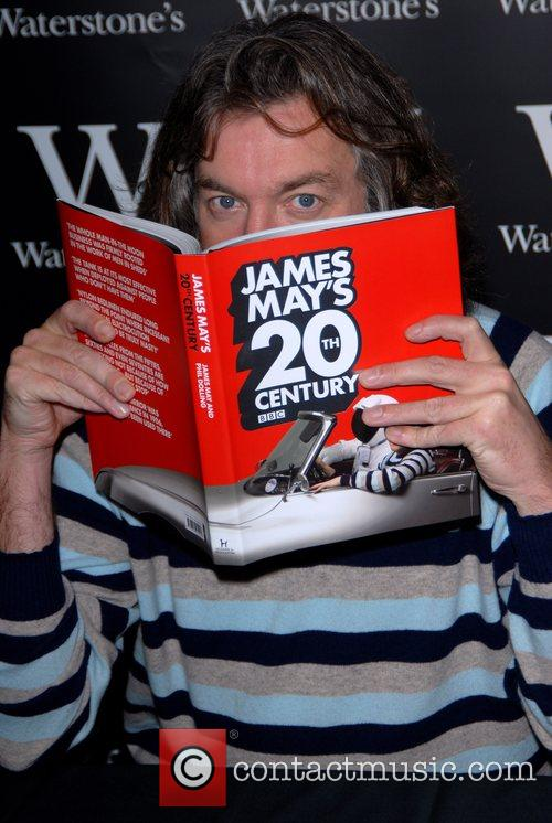 Signing copies of his book 'James May's 20th...