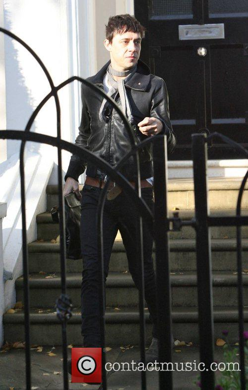 Jamie Hince leaving Davinia Taylor's house carrying a...