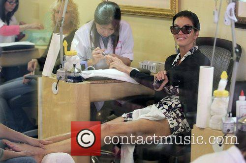 Janice Dickinson gets a manicure and pedicure at...
