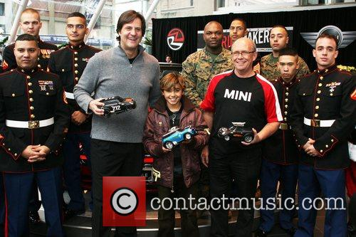 Teams up with 'Mini USA' and 'Ridemakerz' to...
