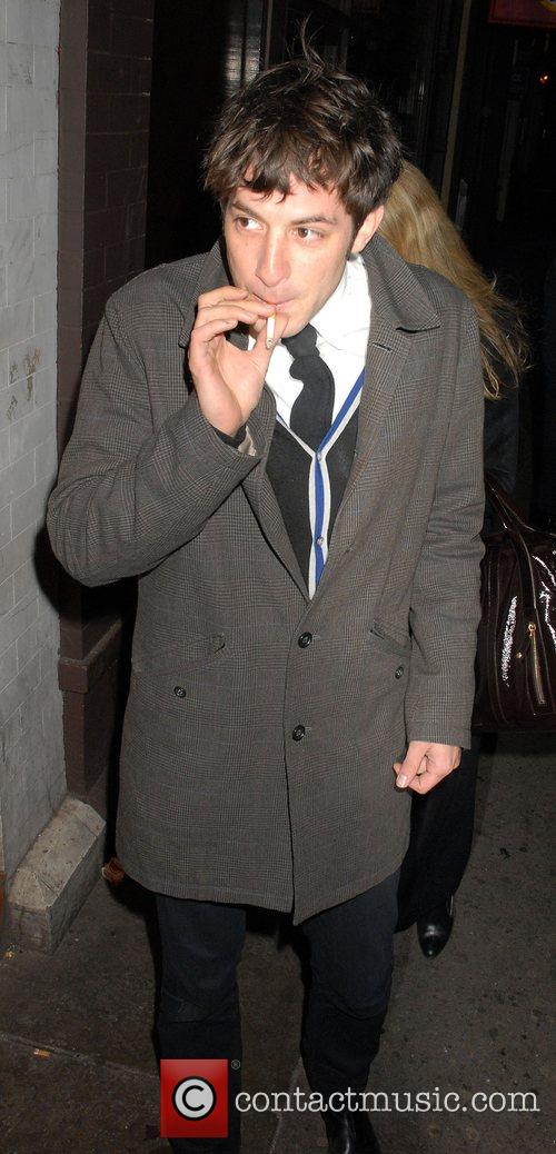Mark Ronson smoking a cigarette while leaving Jazz...