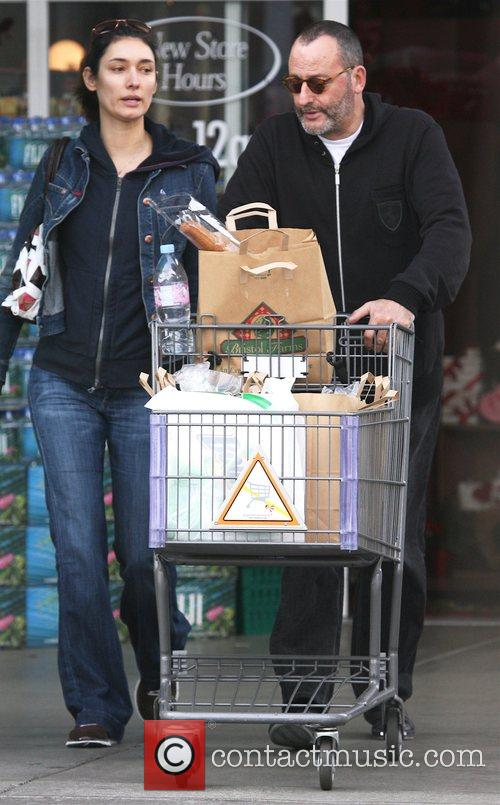 Nathalie Dyszkiewicz and French actor Jean Reno shopping...