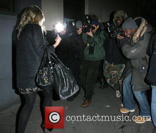 Photographers battle to take pictures of Jennifer Ellison...