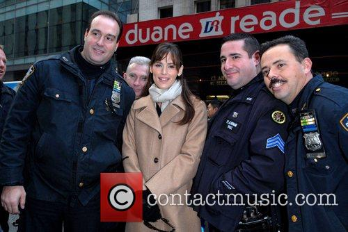 Poses with New York City Police Officers as...