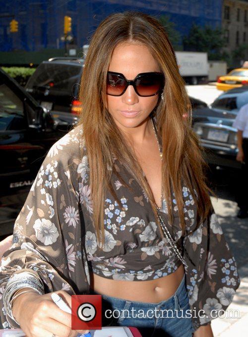 Jennifer Lopez signs autographs outside the Regency Hotel...