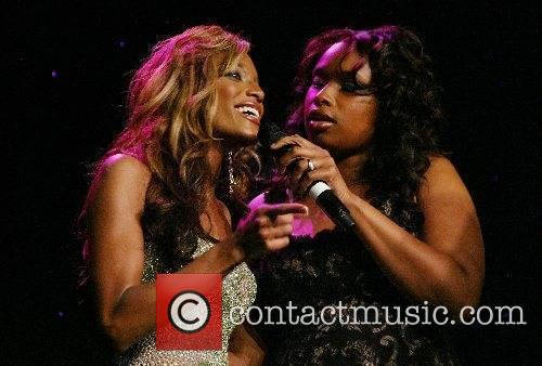 Jennifer Hudson and a guest performing live at...