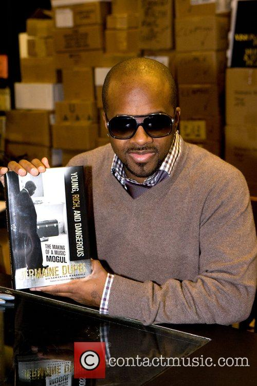 Signs copies of his new book