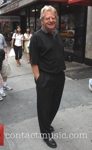 Chat show king Jerry Springer walking on Broadway...