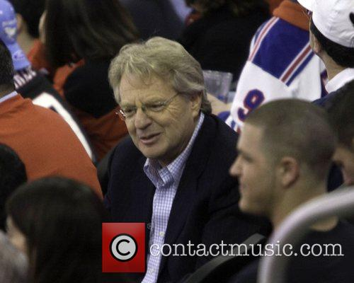 Jerry Springer watching a NHL playoff game between...