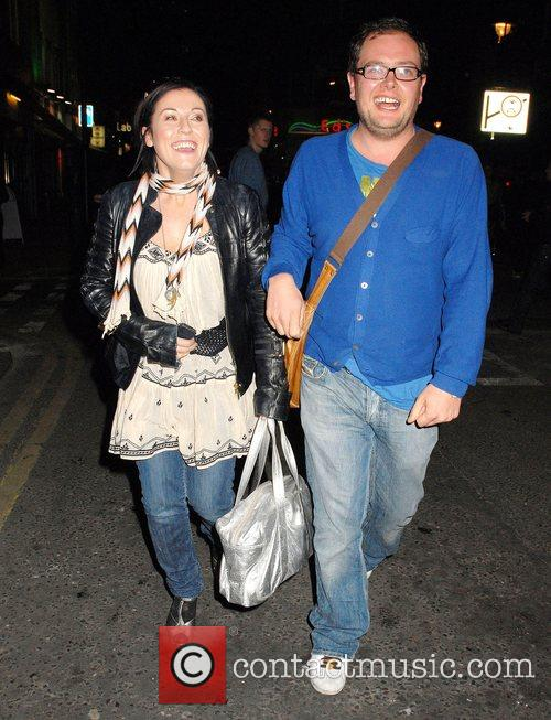 Jesse Wallace and Alan Carr walking along Soho...